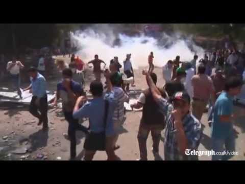 US embassy protests: youths clash with police in Cairo