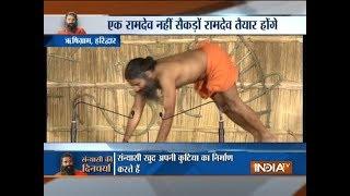 Swami Ramdev performs yoga with 90 sanyasis at Rishigram in Haridwar - INDIATV