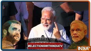 Lok Sabha Elections 2019: Vote करने के बाद PM Modi ने दिखाया वोट का निशान, लोगों में भारी उत्साह - INDIATV