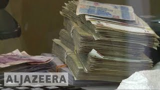 Iran arrests currency traders as rial plummets - ALJAZEERAENGLISH