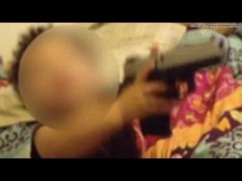 Shocking video shows toddler playing with gun