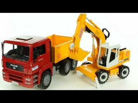 MAN TGA Construction Dump Truck and Liebherr Excavator