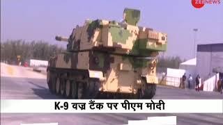 PM Modi rides K-9 Vajra Self Propelled Howitzer - ZEENEWS