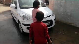 On cam: School teacher makes students clean her car - TIMESOFINDIACHANNEL