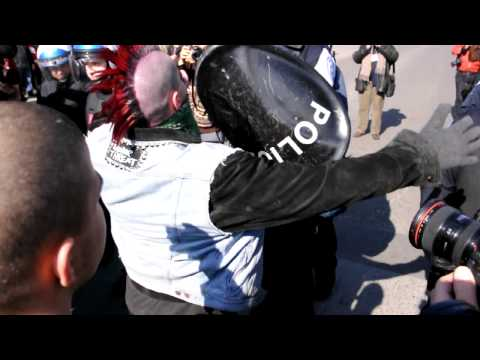 "A ""Punk"" Sporting A Bright Red Mohawk Confronts Riot Police During COBP Protest"