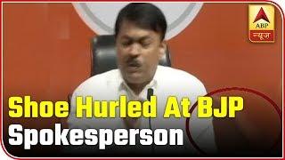 Delhi: Shoe hurled at BJP spokesperson - ABPNEWSTV