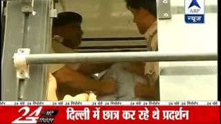 Delhi Police ACP thrashes protester inside the bus - ABPNEWSTV