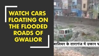 Watch cars floating on the flooded roads of MP's Gwalior - ZEENEWS