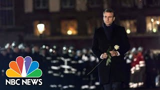 French President Emmanuel Macron Pays Respects At Strasbourg Christmas Market | NBC News - NBCNEWS