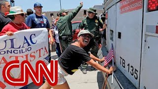 Protesters block bus at immigration site - CNN