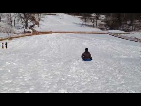 Em sledding in Galena
