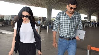 Karisma Kapoor and rumoured beau Sandeep Toshniwal snapped together at the airport - TIMESOFINDIACHANNEL