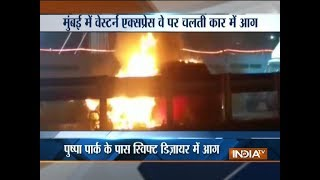 Car catches fire on Mumbai Western Express Highway - INDIATV