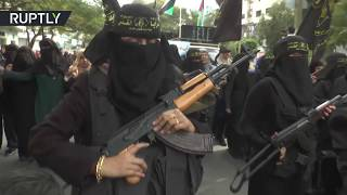 Armed women from Islamic Jihad protest Trump, burn USA & Israeli flags - RUSSIATODAY