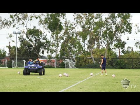 Robbie Keane plays target practice at training