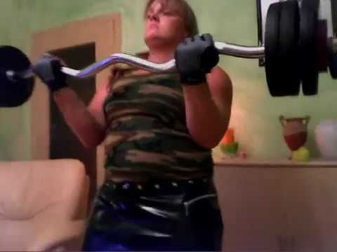 Anna-Konda curls serious iron and poses thick muscle