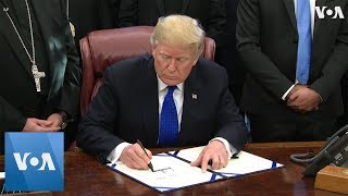 Trump Signs Bill to Help Minorities in Iraq, Syria - VOAVIDEO