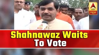 Supaul: Shahnawaz Hussain waiting at poll booth due to EVM glitch - ABPNEWSTV