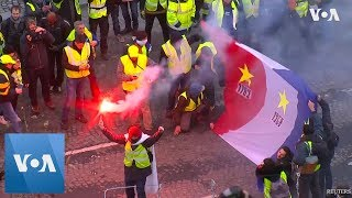 French Police Use Tear Gas Against Protesters in Central Paris - VOAVIDEO