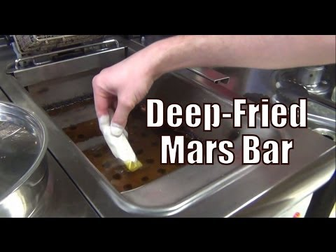 Eating a Deep-Fried Mars Bar along with a Battered Snickers and Twix bar in Edinburgh, Scotland