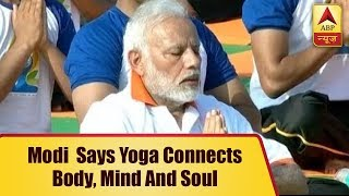 Dehradun: PM Modi performs Yoga at FRI with thousands of volunteers, says 'it connects min - ABPNEWSTV