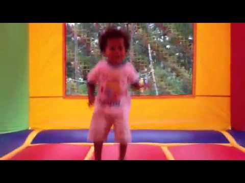 Baby jumping on the bounce house