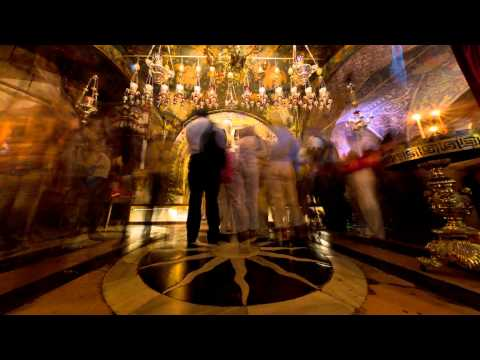 Tracking footage of pilgrims at an altar in the Church of the Holy Sepulchre