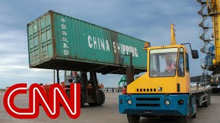 China retaliates after US imposes new tariffs on goods - CNN