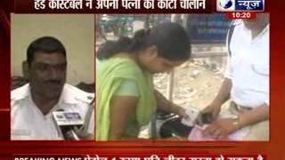 Policeman cuts challan of his wife for violating traffic rules in Ghaziabad - ITVNEWSINDIA