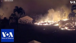 A time-lapse video of lava flowing towards house in Hawaii - VOAVIDEO