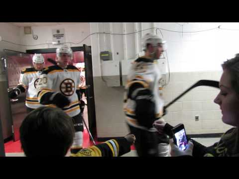 Boston Bruins exit locker room and Courtney High Five's all of the team.