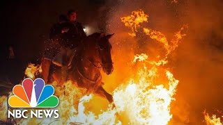 Horses Leap Through Flames At Plague-Related Festival In Spain | NBC News - NBCNEWS