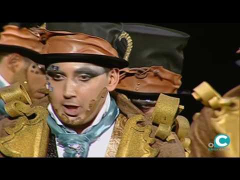 La agrupación El hombre de los mil rostros llega al COAC 2017 en la modalidad de Comparsas. En años anteriores (2016) concursaron en el Teatro Falla como Los guapos, consiguiendo una clasificación en el concurso de Preliminares.