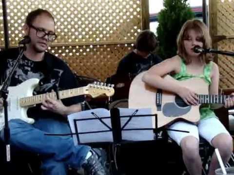 11 Year old girl makes singing/guitar debut at cigar bar and brings down the house!