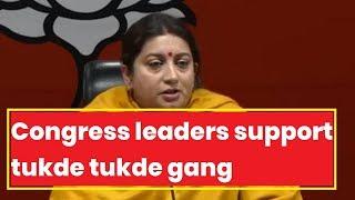 Smriti Irani slams UPA over 'sedition row', Congress leaders support tukde tukde gang - NEWSXLIVE