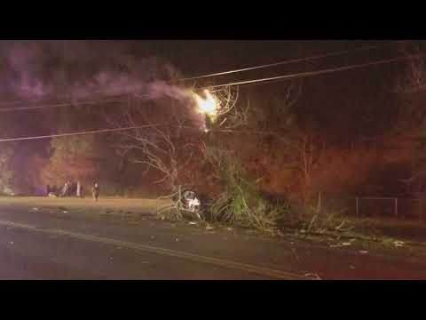Collision causes pole, tree to catch fire