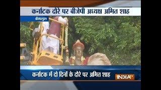 BJP President Amit Shah pays tribute to Lingayat philosopher Basaveshwara in Bengaluru - INDIATV