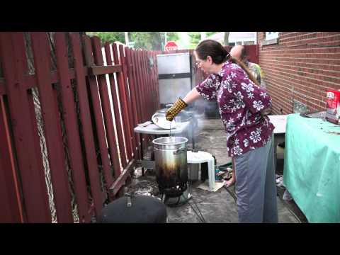 Deep frying chickens in peanut oil.
