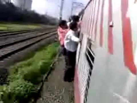 man falling from a train in india mumbai