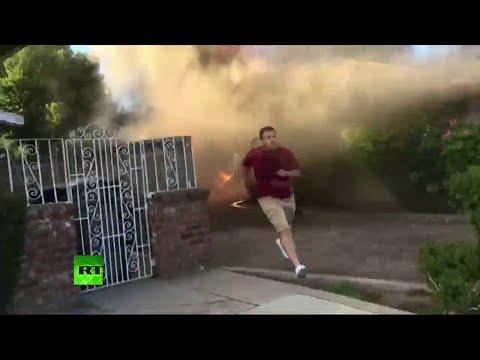 Héroe anónimo salva un hombre de una casa en llamas