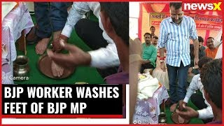 Shocking visuals from Jharkhand; BJP worker washes feet of BJP MP - NEWSXLIVE