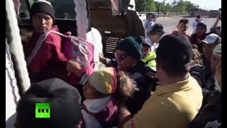 Migrants board buses to get closer to US-Mexico border - RUSSIATODAY