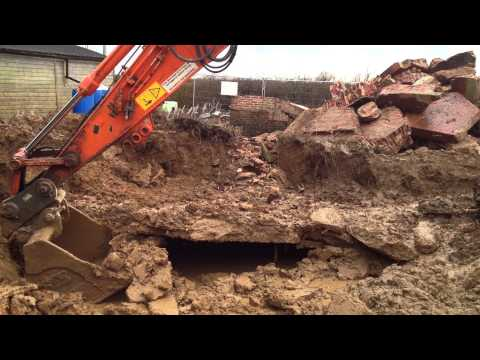 Eco house build 18e: Demolition - digger struggles in mud