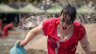 Sue takes part in the Dai water splashing - The Mekong River with Sue Perkins: Episode 4 - BBC Two - BBC