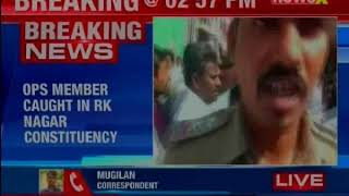 OPS faction member caught distributing money; nabbed by police, CRPF - NEWSXLIVE