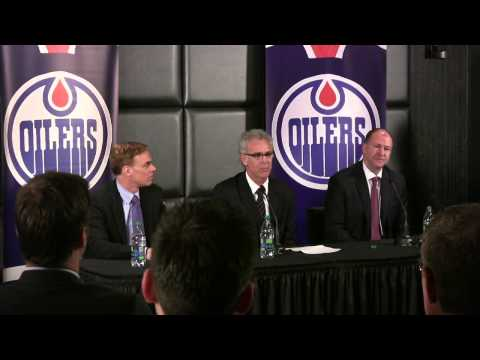 Edmonton Oilers management reacts during questioning at GM m