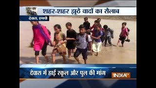 Madhya Pradesh: Children take risk to cross flooded river to reach school - INDIATV