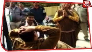जब लाचार महिला ने दरोगा के पैरों में गिरकर लगाई गुहार - AAJTAKTV