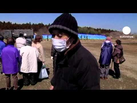 Temporary mass graves for Japan tsunami victims