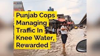 Thanks To Social Media! Cops Managing Traffic In Knee Water Rewarded - ABPNEWSTV